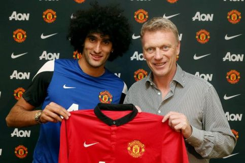 £££75-Marouane-Fellaini-poses-with-David-Moyes-after-signing-for-the-club-2246839